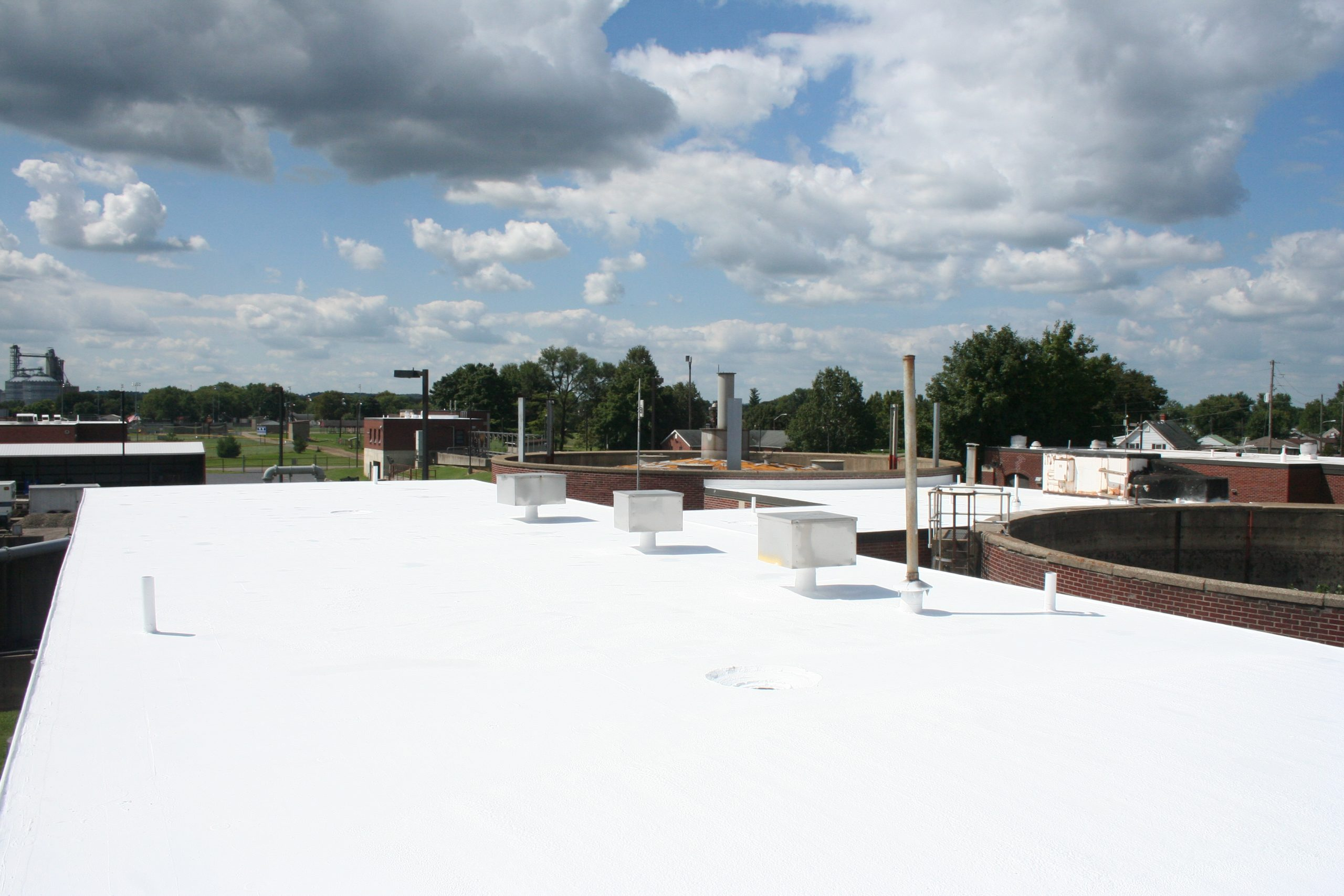 white roofing on a complex.